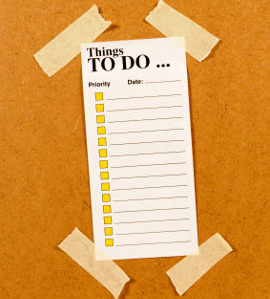 To Do List taped to a wooden board
